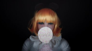 4K Halloween Shot of Doll Make-up Woman with Lollipop