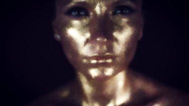 4k Studio Shot of a Golden Glittery Face Woman