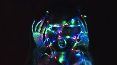4k Studio Shot of a Golden Glittery Body Woman Posing with Lights