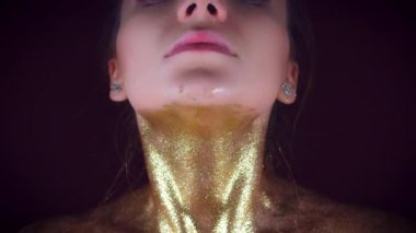 4k Studio Shot of a Golden Glittery Body Woman, zoom out