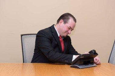 Caucasian male model in business/educational setting