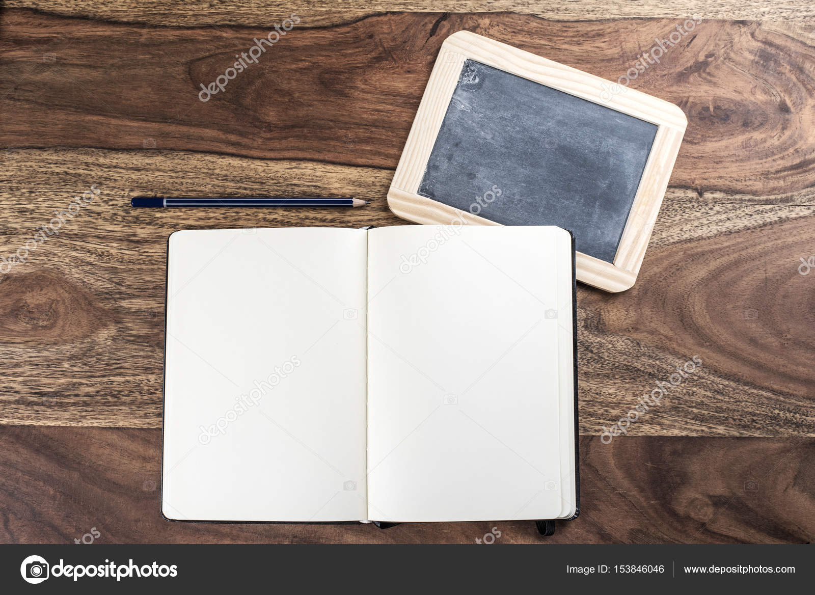 open plain empty page notebook with pencil and blackboard on rustic
