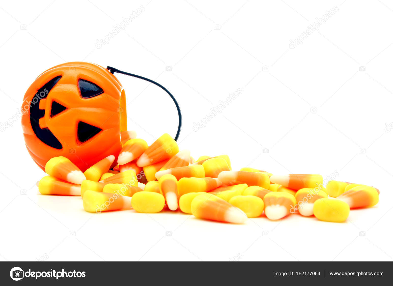 pumpkin candy holder with spilling halloween candy corn — stock