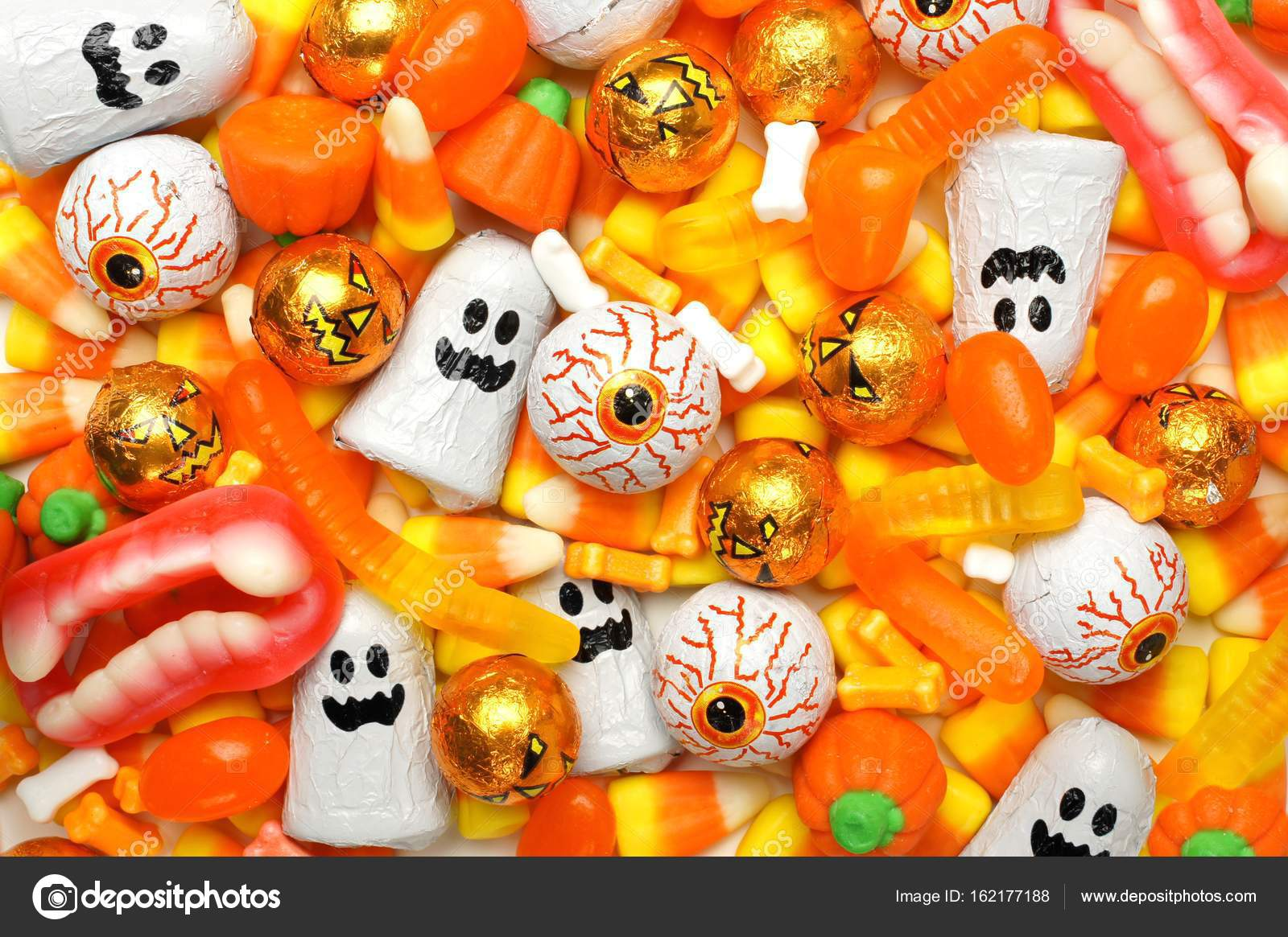 orange themed halloween candy background stock photo jenifoto