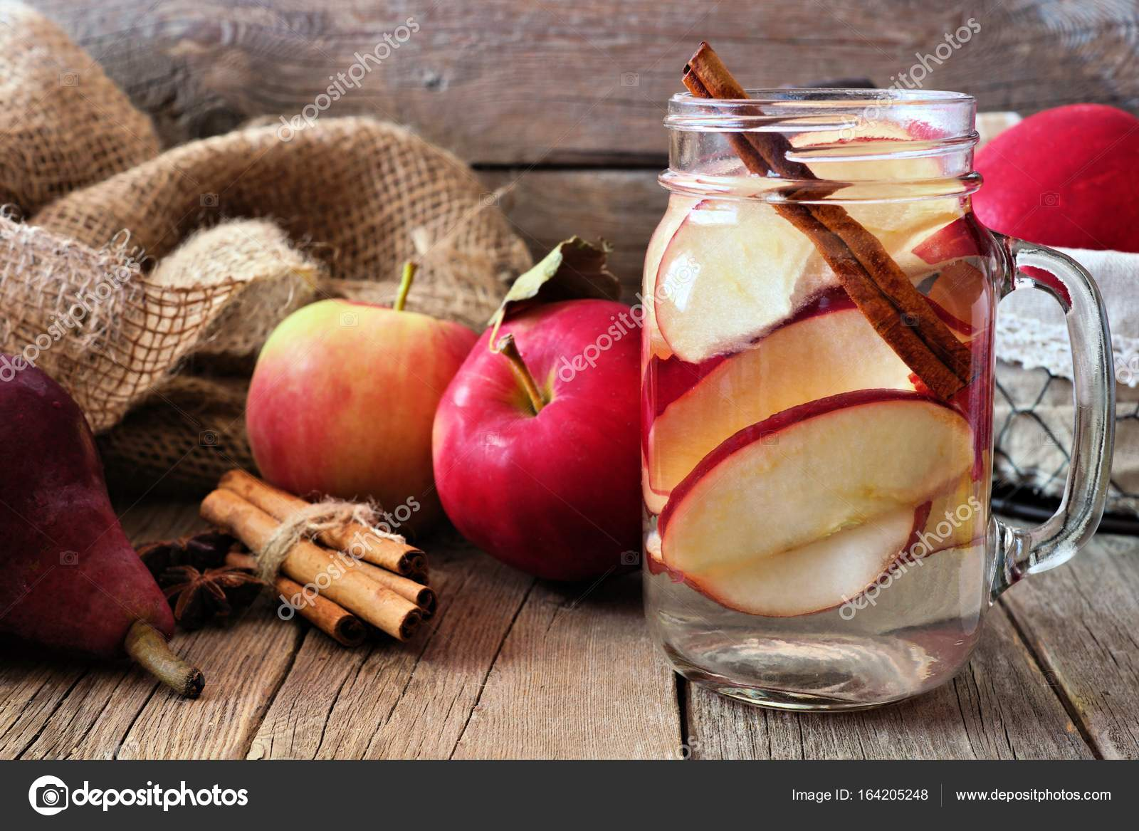 Autumn Themed Detox Water With Apple Cinnamon And Red Pear In A Mason Jar Scene On Rustic Wood Background Photo By JeniFoto