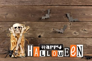 Wooden Happy Halloween sign with jar of bones