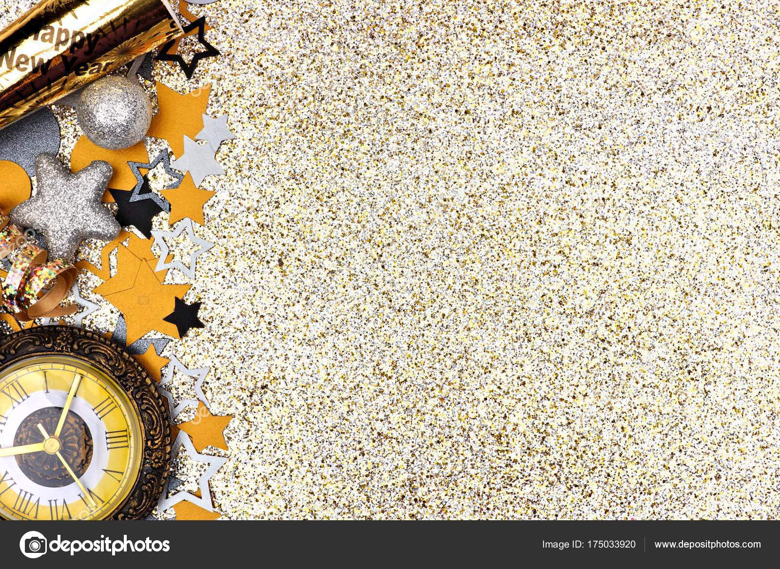new years concept side border confetti clock party noisemaker glittery stock photo