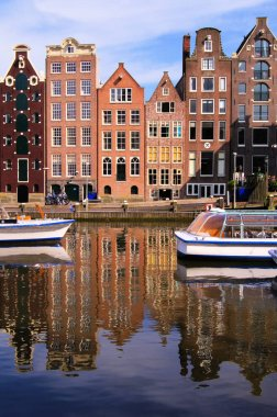Canal houses of Amsterdam, Netherlands with reflections