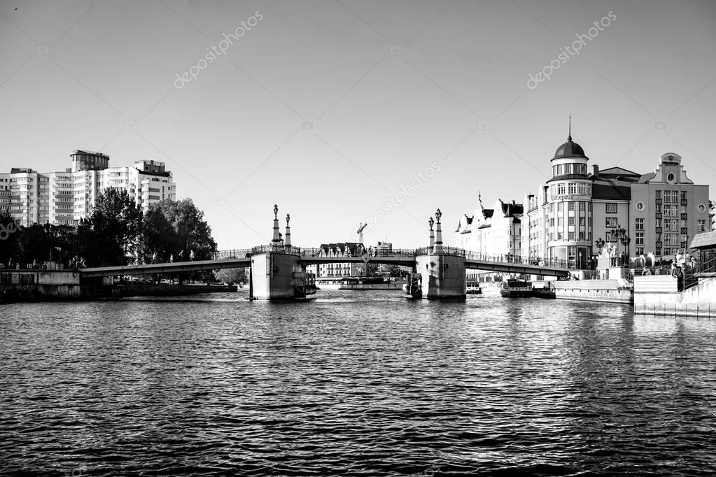 cityscape with view of the river and the architecture of the city in black and white.