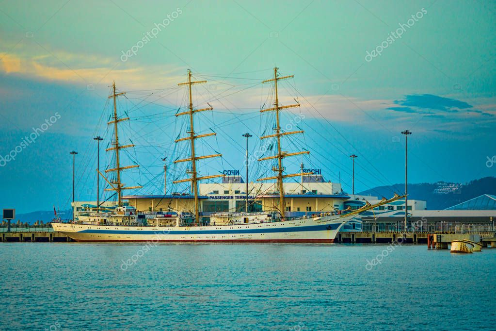 Sailing ship Mir at the pier in the modern seaport of the Russian city.