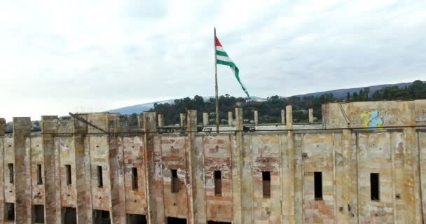 city landscape destroyed building which abkhazian flag flying