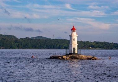 Tokarevsky lighthouse on the background of the sea. Vladivostok, Russia