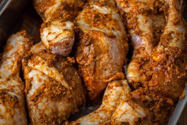 Marinated chicken drumsticks ready for baking.
