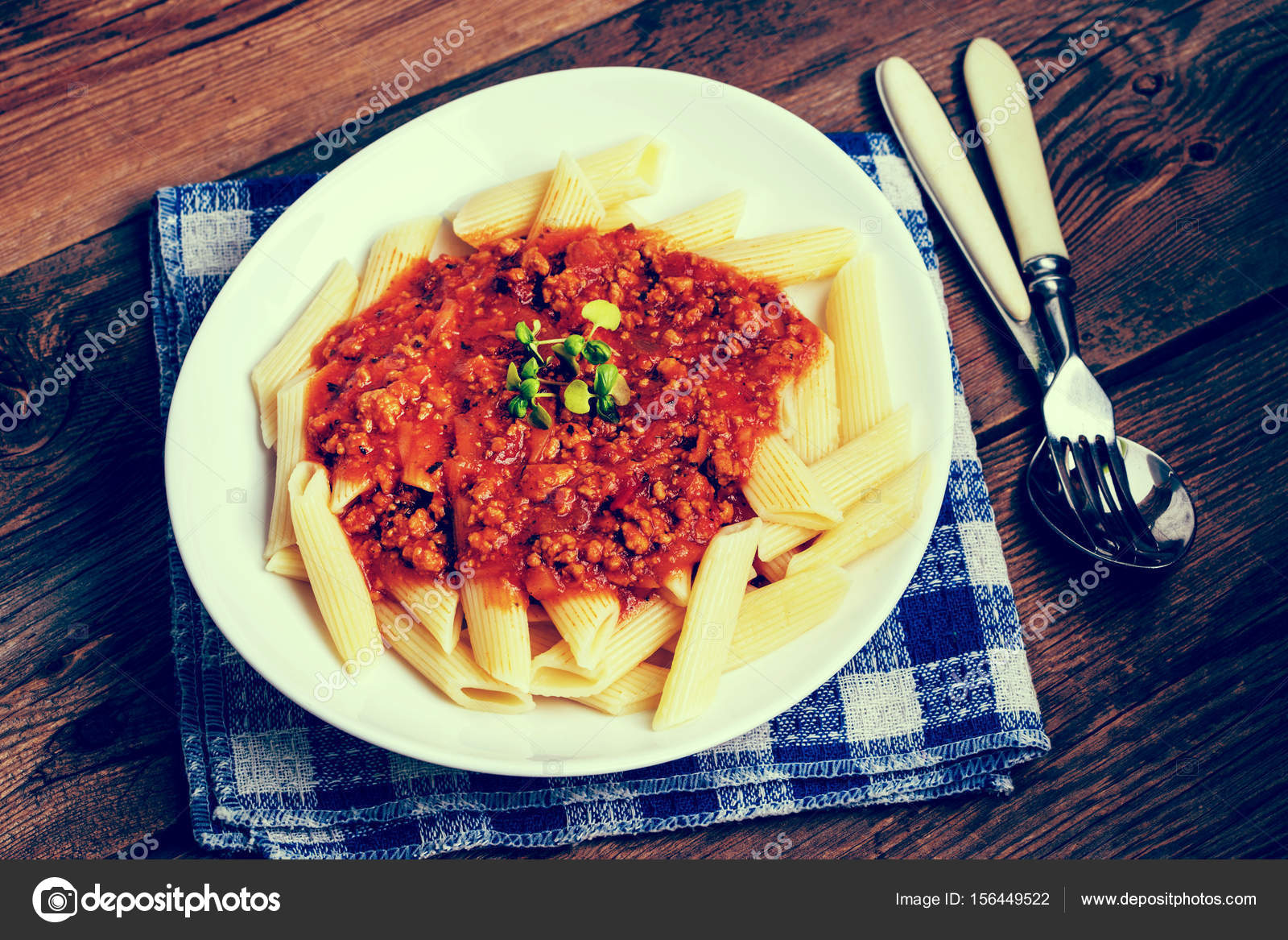 Pasta penne with tomato bolognese sauce. Instagram style filtred 18