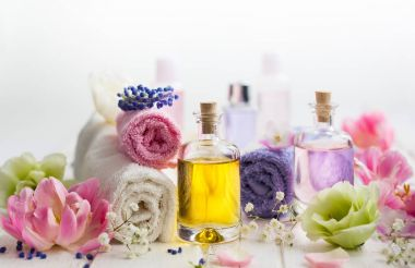 aroma oil with towels and flowers