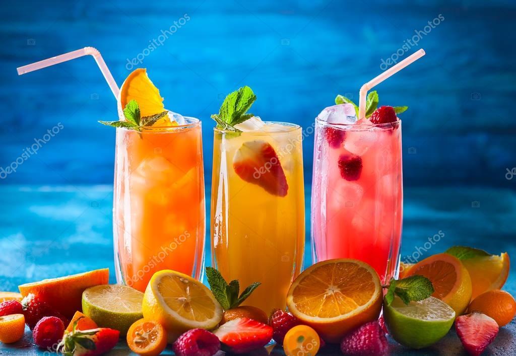 Summer fruit drinks on table
