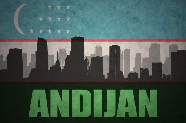 abstract silhouette of the city with text Andijan at the vintage uzbekistan flag background
