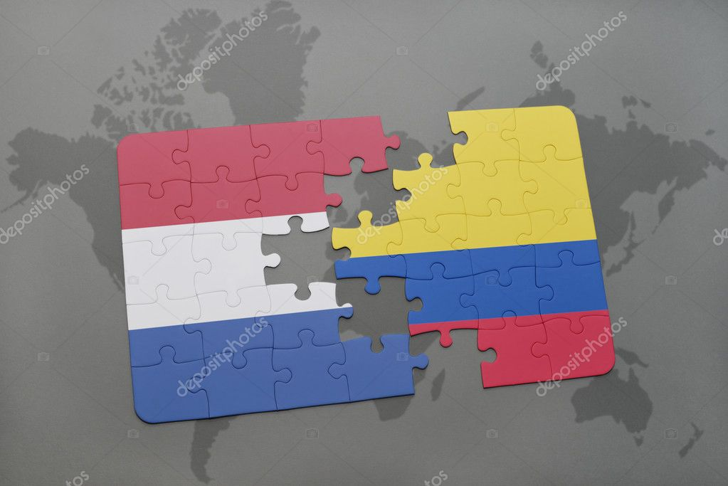 Puzzle with the national flag of netherlands and colombia on a world puzzle with the national flag of netherlands and colombia on a world map background gumiabroncs Images