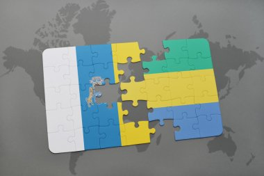 puzzle with the national flag of canary islands and gabon on a world map background.