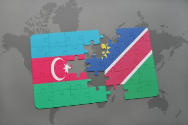 puzzle with the national flag of azerbaijan and namibia on a world map