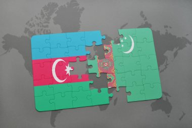 puzzle with the national flag of azerbaijan and turkmenistan on a world map