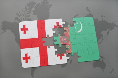 puzzle with the national flag of georgia and turkmenistan on a world map