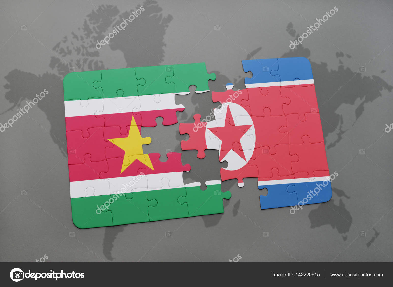 puzzle with the national flag of suriname and north korea on a world ...