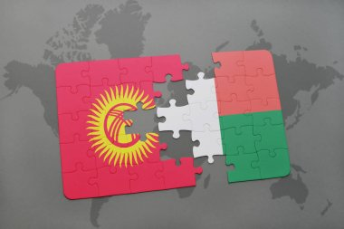 puzzle with the national flag of kyrgyzstan and madagascar on a world map