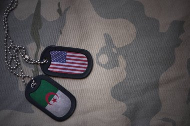 army blank, dog tag with flag of united states of america and algeria on the khaki texture background. military concept