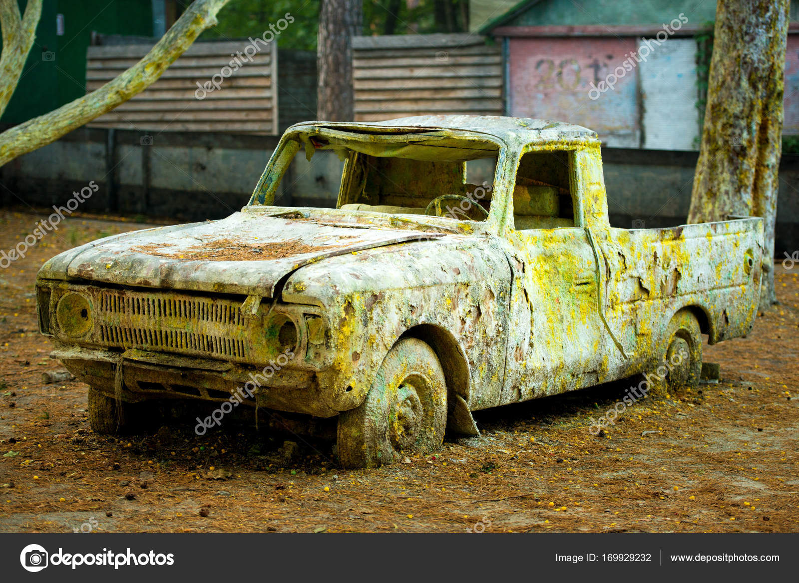 An old rusty car in paint from paintball. — Stock Photo © Yarkovoy ...