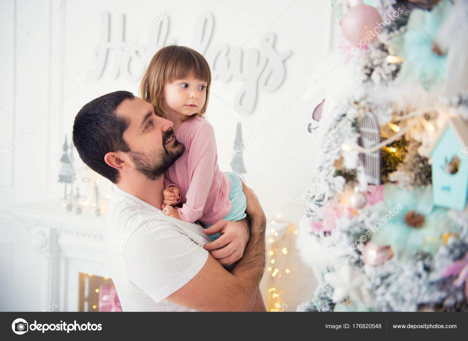 little daughter and father near christmas tree happy new year stock photo