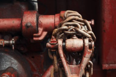 Old farm tractor hydraulic lift arm and chain detail