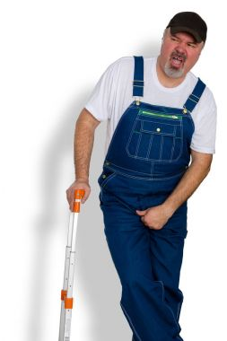 Worker clutching his groin in discomfort