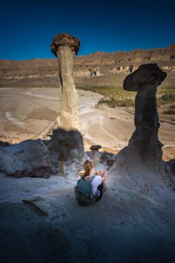Hiker resting looking at Wahweap Hoodoos near Kanab