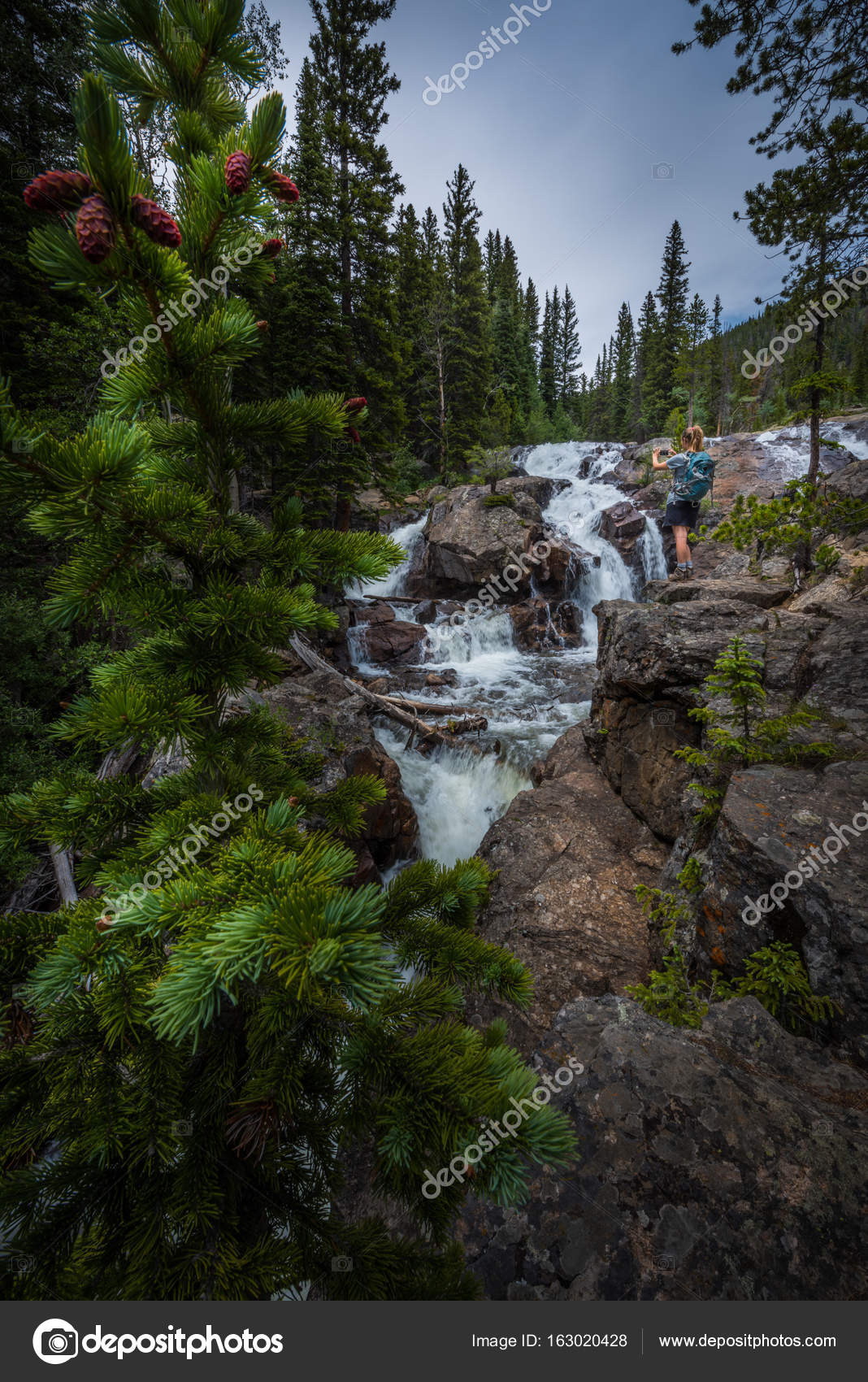 backpacker near jasper creek falls colorado indian peaks wildern stock photo