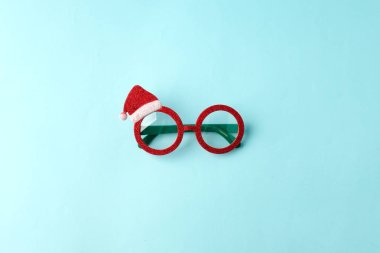 glasses Santa's Christmas on blue background. Masquerade party n