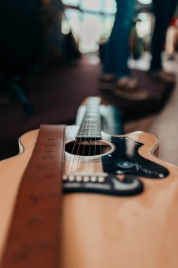 close-up of acoustic guitar on background