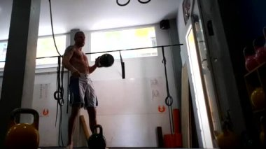Kettlebell Alternating Dead Swing Clean and Press
