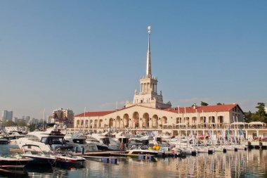 The Building of the marine station and sailboats in Sochi in the evening