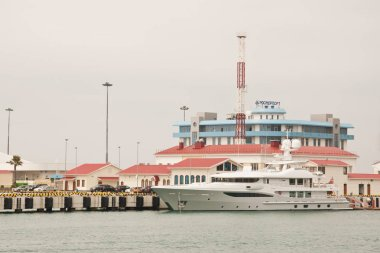 Big yacht on the background of the building of Rosmorport Sochi