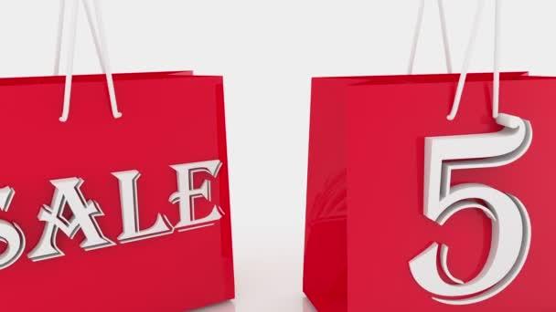 Přesouvání nákupní tašky s nápisem 50 procent