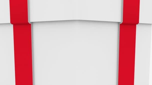 Dárková krabice s červenou mašlí na bílém