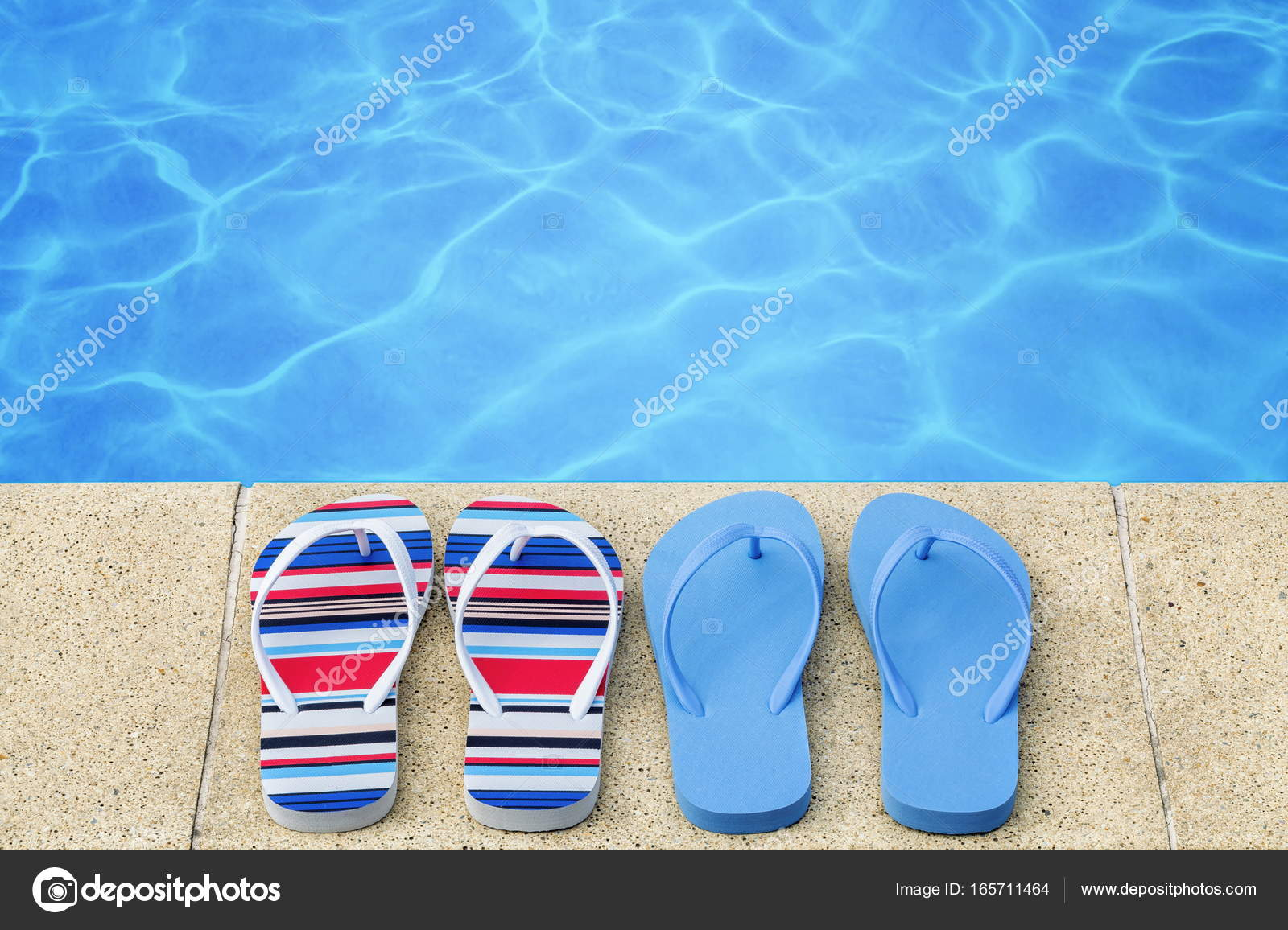 7780793c6f9125 Flip flops near swimming pool — Stock Photo © ilze79 #165711464