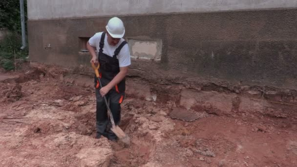 Worker dig out ground in trench