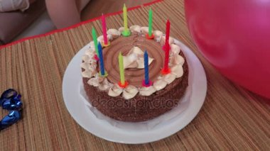 woman hand cutting birthday cake with candles Stock Video