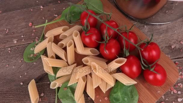 Italian pasta and tomatoes on table