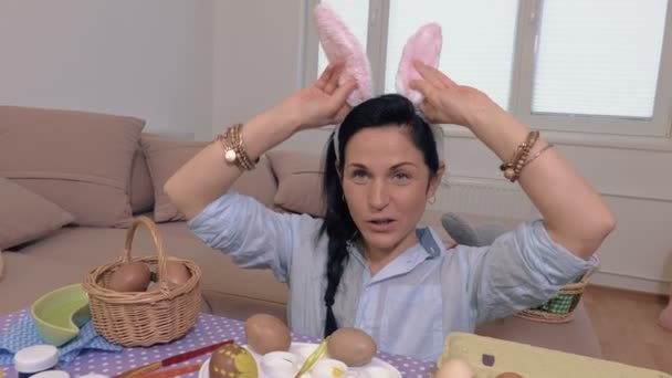Woman plays with bunny ears