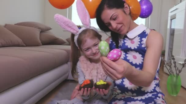 Mother and daughter with decorative Easter eggs