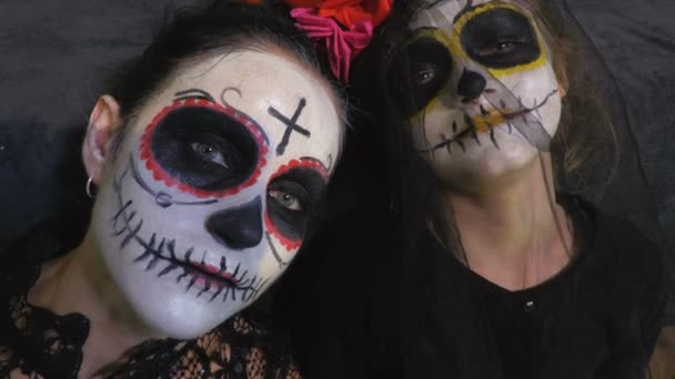 Mother and daughter with Day of the Dead make up.Halloween makeup ideas concept