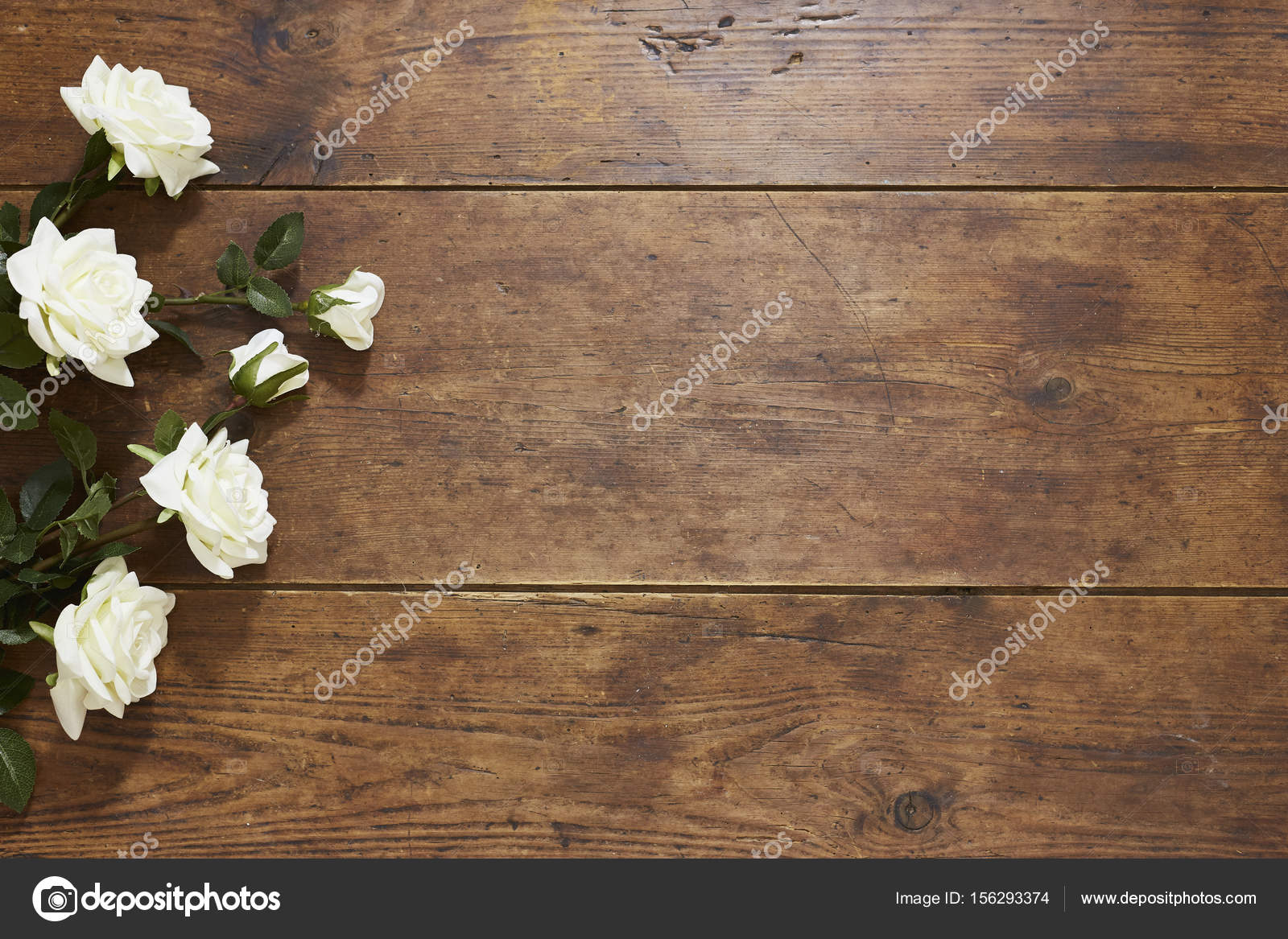 Roses On Rustic Wood Background Stock Photo